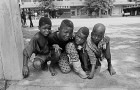 Cedric Nunn, Street Children in war-torn Mozambique, Maputo, 1990, courtesy of Bailey Seippel Gallery, ©C. Nunn